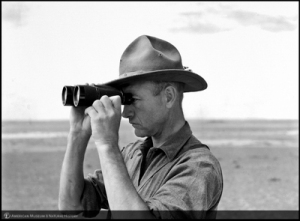 """Shackelford, James B., """"Roy Chapman Andrews looking through binoculars, Mongolia, 1928,"""" AMNH Digital Special Collections, accessed January 24, 2015, http://images.library.amnh.org/digital/items/show/25647."""
