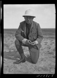 """Professor Henry Fairfield Osborn with fossil tooth near Irdin Manha, Inner Mongolia, China, 1923,"" Granger, Walter, AMNH Digital Special Collections, accessed February 26, 2015, http://images.library.amnh.org/digital/items/show/20215."